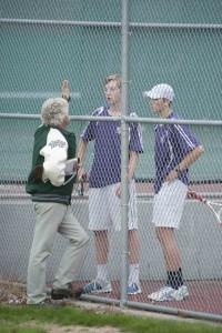 Teer and Rettenmeier confer with coach Dan Crist between sets.