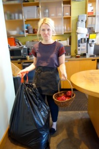 """A grieving Sarah, barista at Walnut Street Coffee, holding the bag containing the remains of Johnny Appleseed. """"It was so senseless,"""" she said. """"They didn't even eat the apples."""""""