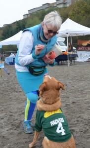 Edmonds City Councilmember Diane Buckshnis, an avid Green Bay Packers fan, with her dog Spike.