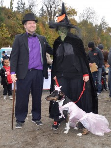Best owner/dog combination, second place: Oz, the Wicked Witch and Glinda, featuring Amadaya (as Glinda) with Scott (Oz) and Tanya Crawford from Camano Island.