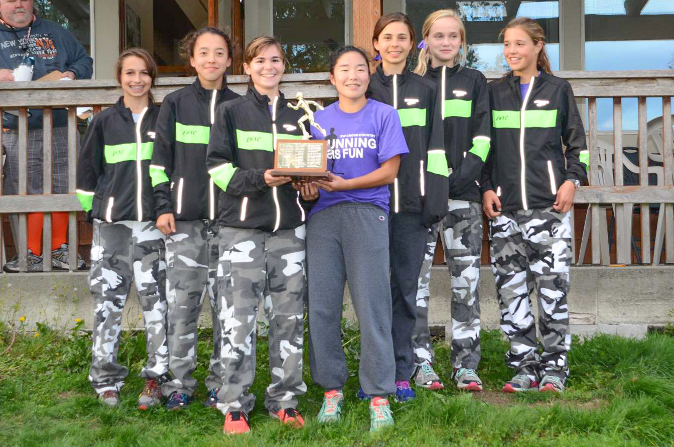 Edmonds-Woodway's girls show off their first place trophy.