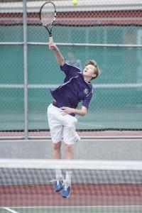 Teer's doubles partner Jack Rettenmeir serves.