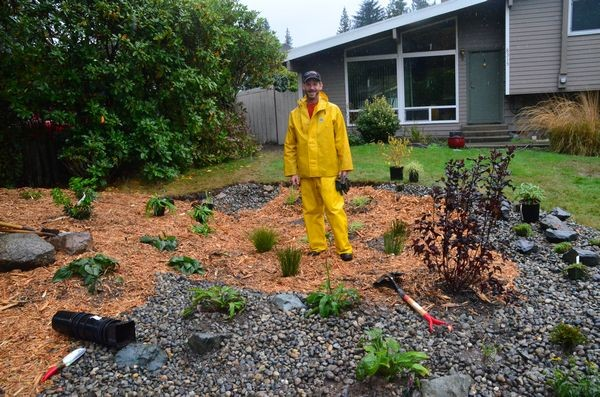 Mike Cawrse of the City of Edmonds Public Works Department helps indentify areas in Edmonds where rain gardens would have the greatest benefit in controlling runoff.