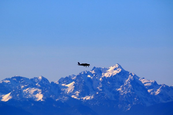 From Bill Anderson: A recent storm dropped snow on the Olympic Mountains, which made a more scenic background for this shot Saturday afternoon of a private plane flying over Puget Sound.