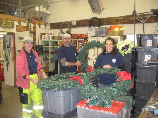 010 Parks crew checking lights & bows for 56 wreaths for downtown light posts(1)