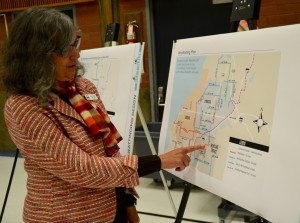 Mountlake Terrace Traffic Engineer Janet Hall points to the Mountlake Terrace location where bicycle wayfinding signs will be added.