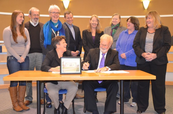 City of Edmonds Parks, Recreation and Cultural Services Director Carrie Hite and Mayor Dave Earling, seated, are joined by