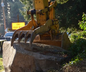 The excavator at work on 80th near 220th Street Southwest.