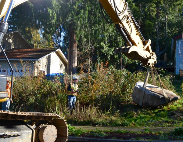 Crews unload Granite onto the Moodys' yard.