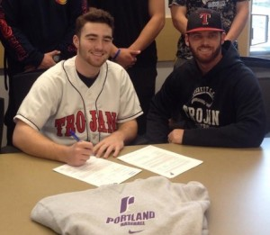 Tate Budnick signing his letter of intent with Cody Atkinson the assistant coach/hitting coach.