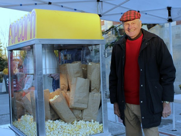 Edmonds Historical Museum board member Jack Hall at the helm of the popcorn machine.