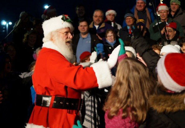 """Santa yells out to the kids, """"Give me a high five!"""""""
