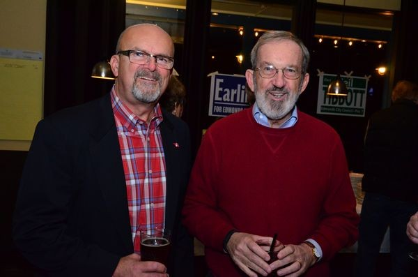 Newly-elected Councilmembers Dave Teitzel and Tom Mesaros celebrate at Portofino's Tuesday.