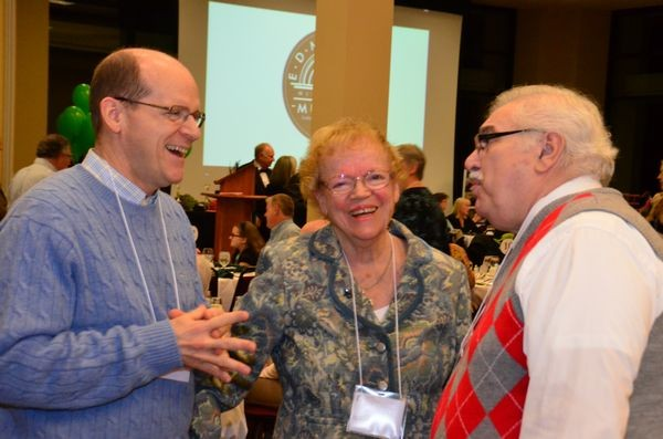 Barbara Chase and her son visiting from out of town chat with Frank DeMiero. DeMiero was honored for his years of efforts bringing music to the community with the annual DeMiero Jazz Fest and the Sno-King Community Choral. Chase is a long-time member of the Edmonds Floretum Garden Club, honored this year as Edmonds citizen of the year, the first time the award has been given to a group.