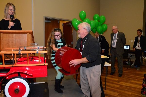 The winner of this years pedal fire truck raffle was chosen by student essay contest winner Maura Canney, assisted by Dean Larson and emcee Teresa Wippel.