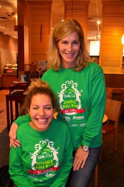 Lauren Little and mom JoAnne Little model this year's Jingle Bell Run t-shirt.