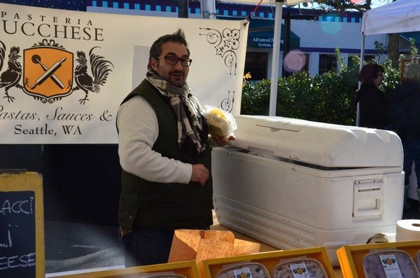 """Greeting visitors with his signature cheery """"Bonjourno!"""" Samuele Lucchese offered market patrons several varieties of his delicious hand-made pasta. Lucchese, a fixture at the Spring and Summer Markets, is well-known to Edmonds Market visitors for his outgoing personality and gourmet products."""