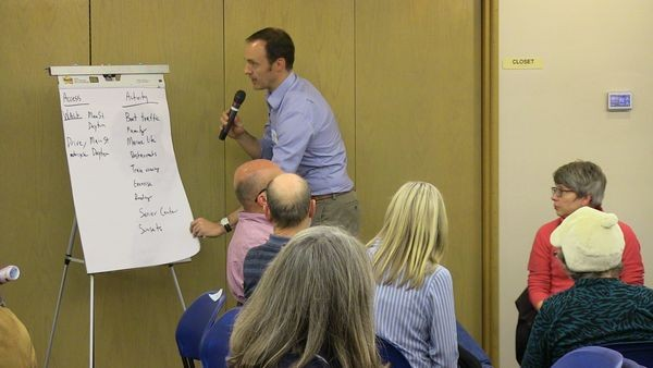 Royce Napolitino presents the ideas generated in his breakout group to the full audience.