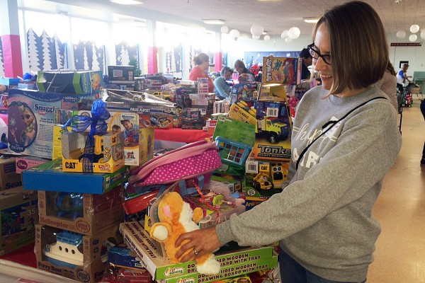 Volunteer Sheri Ambacher assists with sorting and preparation for the Toy Shop opening on on Saturday,