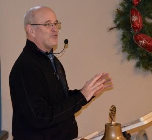 Neil Tibbott speaks to Edmonds Noon Rotary Club members Tuesday.