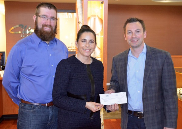 At right, Andy Cline, owner of Cline Jewelers in downtown Edmonds, presents a $2,100 check to Deborah Anderson, executive director of the Foundation for Edmonds Public Schools and Casey Auve, Foundation Board president, Wednesday morning. Cline committed to donFriday-Sunday, Nov. 28-30, Cline Jewelers will be donating 10 percent of sales to the Edmonds School District Foundation's Nourishing Network program. The program goal is to help provide weekend meals for homeless and low-income students in the Edmonds School District.