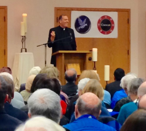 """Pastor Terry Kyllo takes the podium at Trinity Lutheran Church for the community gathering, """"Love in a Time of Fear: Muslims and Christians as Good Neighbors."""