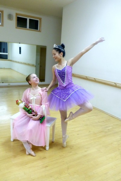 Clara in the pink is Bella Brewer and Sugar Plum Fairy in purple is Paige Ryan.
