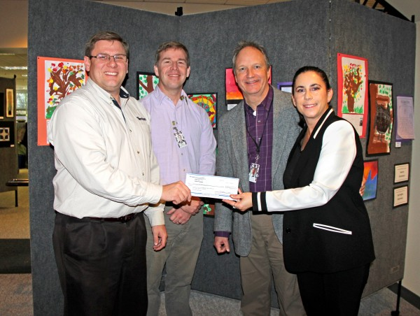 On Friday, the Foundation received a $2,500 donation from Terracon in support of the Nourishing Network.  In the picture are Eric Kunz, Patrick Murhpy, Stewart Mhyre and me.  When I get into the office, I will look at Eric's card, and will email his title.