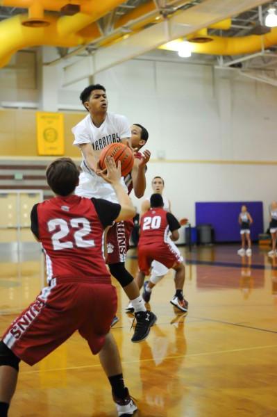 Tre'var Holland elevates to the basket.