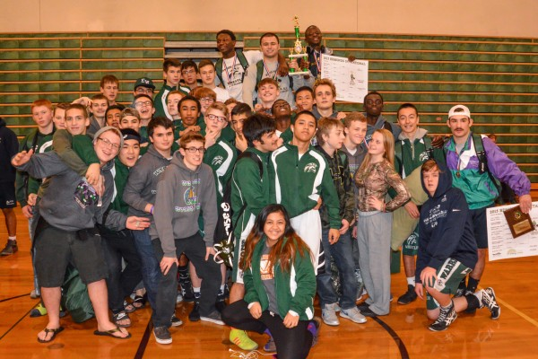 Warrior wrestlers with the third-place trophy. (Photos by Karl Swenson)