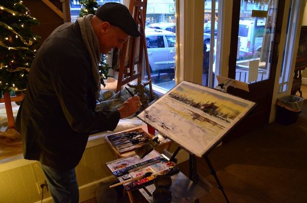 Watercolorist Ron Stocke put some extra touches on his painting at Cole Gallery.