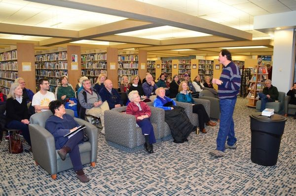 Yeager addresses the group gathered at the library.