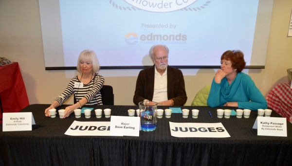 The judges prepare to sample chowder entries.