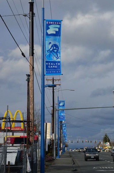 If you've driven along Highway 99 lately between 220th and 215th Streets Southwest, you've likely noticed these new blue poles with banners -- a joint project between Swedish Edmonds hospital and the City of Edmonds to highlight a fitness emphasis. (Photos by Larry Vogel)