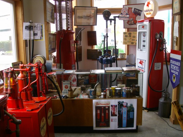 Old gas pumps and other historical items on display.