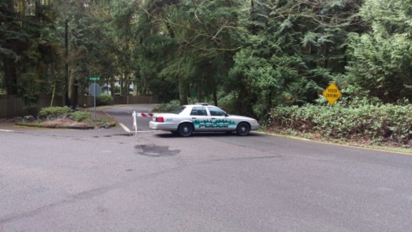 A police car blocks off the road leading to the scene where Amy Kennelly's body was found in Woodway Thursday morning. (Photo by Natalie Covate)