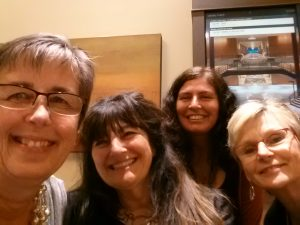 Wendy Kendall, back, with author Ruth Reichl, center, and volunteers Kim Unti, left, and Pam Yates, far right.