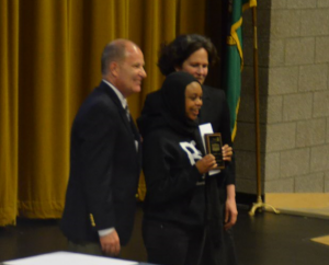 """EWHS senior Bintou Bandeh won the Courage Award for """"refusing to let (abuse, neglect and displacement) define her."""""""