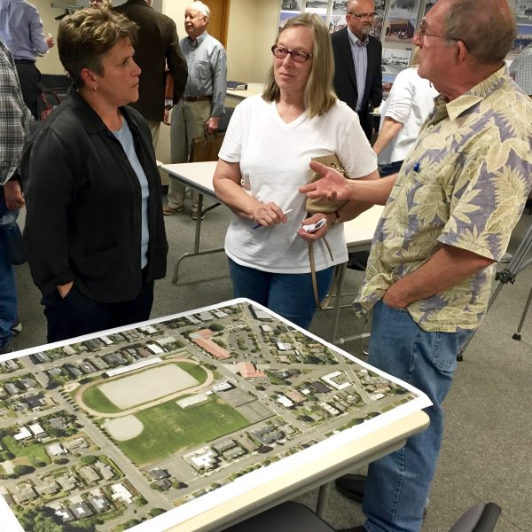 Parks, Recreation and Cultural Services Director Carrie Hite talks with attendees at the end of the meeting.