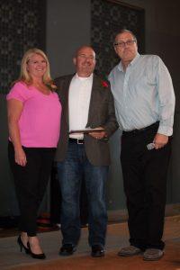 John and Tania Klippart with Mountlake Terrace Athletic Director Kim Stewart