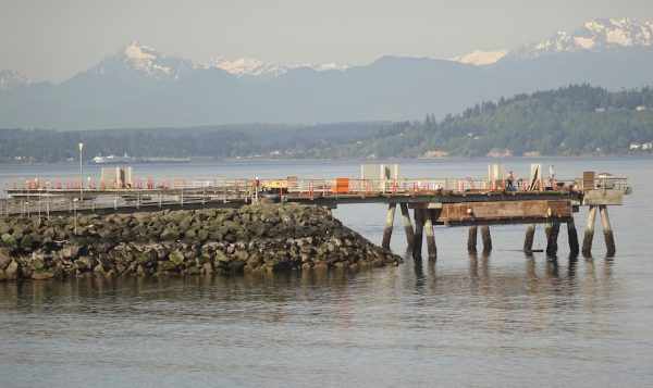 Workers on the Edmonds Fishing Pier in May. (Photo by Wes Carlson)