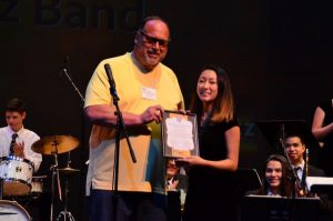 Dale Terwedo awards a $3,000 scholarship to Leslie Cho.