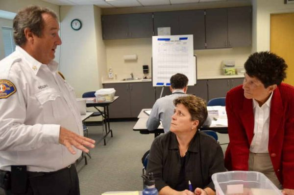 Reading talks with Parks, Recreation and Cultural Services Director Carrie Hite and Development Director Shane Hope.