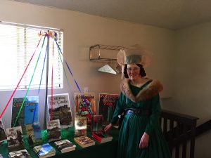 Lila Rhodes has chosen to wear authentic 15th Century English costuming to her book release party.