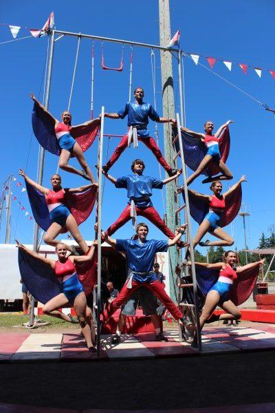 Circus members perform on Roman Ladders.