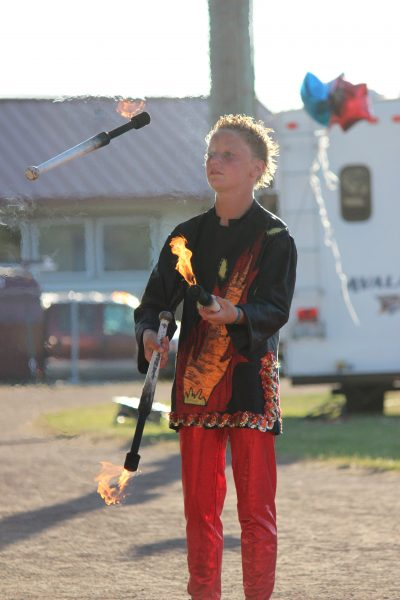 Tristyn Geren, 14, juggles fire. (Photo courtesy Wenatchee Youth Circus)