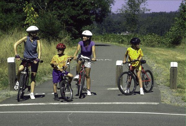 A family enjoys the Centennial Trail.