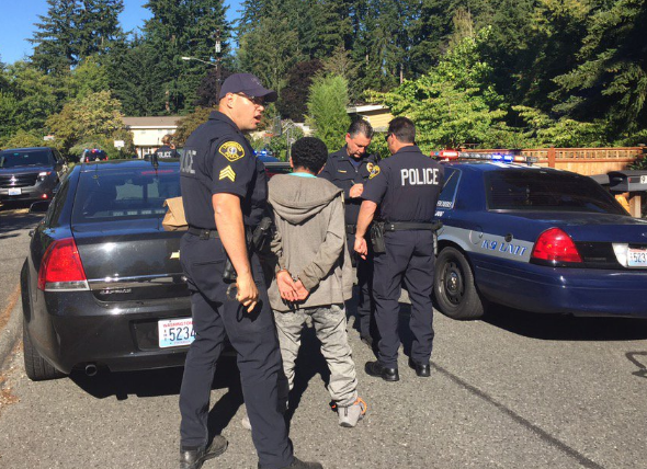 One of the five suspects being taken into custody by Lynnwood Police. (Photo courtesy Lynnwood Police)