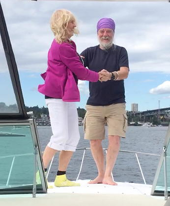 My parents dancing on the bow of the boat.