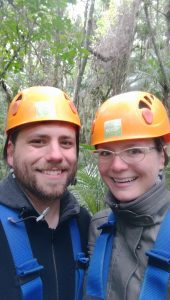 Chris and Natalie taking a walk through the forest after ziplining in New Zealand.